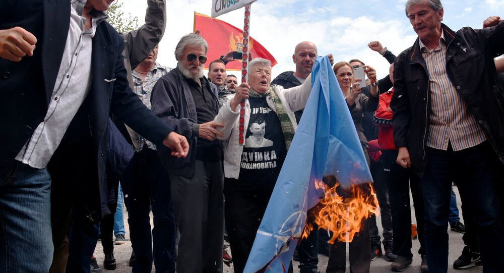 Demonstrators burn NATO flag during anti-NATO protest as Montenegro's parliament discuss ratification of NATO membership agreement in Cetinje, Montenegro, April 28, 2017