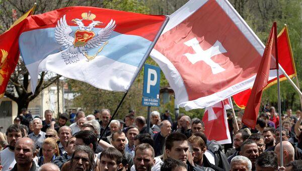 Demonstrators wave flags during anti-NATO protest as Montenegro's parliament discusses NATO membership agreement in Cetinje, Montenegro, April 28, 2017 - Sputnik International
