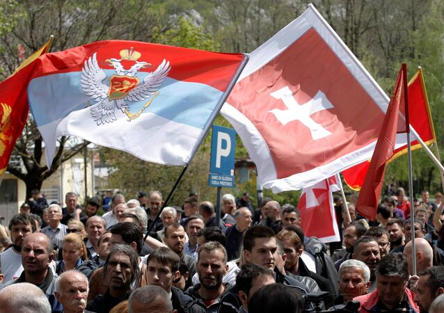 Demonstrators wave flags during anti-NATO protest as Montenegro's parliament discusses NATO membership agreement in Cetinje, Montenegro, April 28, 2017