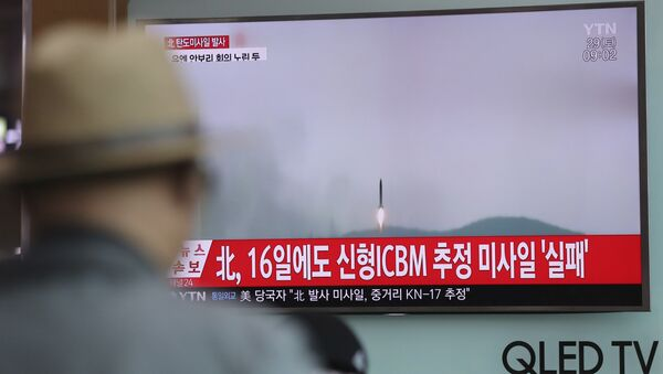 A man watches a TV news program reporting about North Korea's missile firing with a file footage, at Seoul Train Station in Seoul, South Korea, Saturday, April 29, 2017. - Sputnik International
