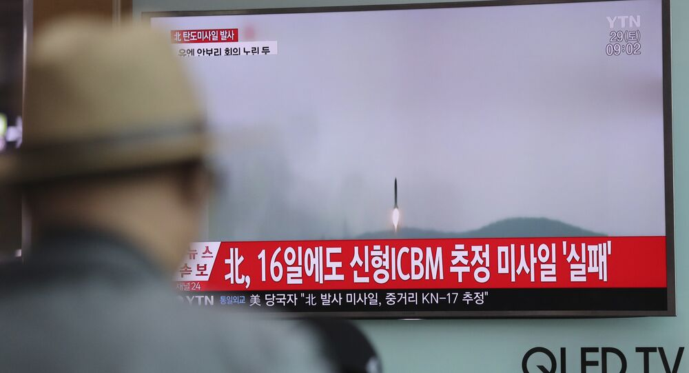 A man watches a TV news program reporting about North Korea's missile firing with a file footage, at Seoul Train Station in Seoul, South Korea, Saturday, April 29, 2017.