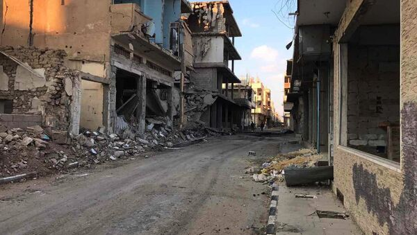 Buildings destroyed during combat activities in the residential part in Homs, Syria. (File) - Sputnik International