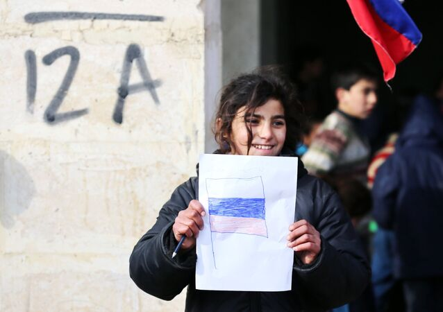 A girl is seen here in the temporary refugee shelter in Jibreen, Aleppo.