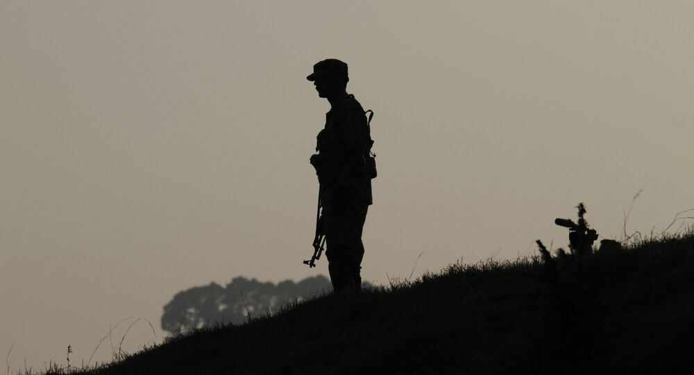 A Pakistan army soldier stands guard at hilltop post at a forward area on the Line of Control (LOC), that divides Kashmir between Pakistan and India. (File)