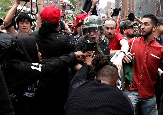 Demonstrators clash with people opposing their rally during a May Day protest in New York City