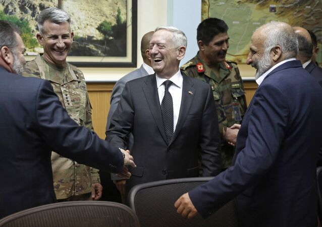 U.S. Defense Secretary James Mattis, center, and U.S. Army General John Nicholson, commander of U.S. Forces Afghanistan, second left, meet with Afghanistan's National Directorate of Security Director Mohammad Masoom Stanekzai, right, and other members of the Afghan delegation at Resolute Support headquarters in Kabul, Afghanistan in Kabul, Afghanistan Monday, April 24, 2017