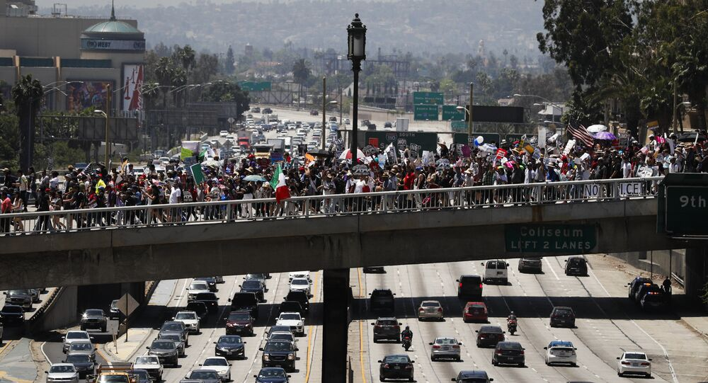 Thousands of protesters march over the 110 Freeway during a May Day rally Monday, May 1, 2017, in Los Angeles.