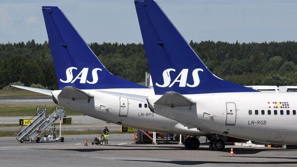 Two Scandinavian Airlines (SAS) Boeing 737 aircraft parked at Terminal 4 of Arlanda Airport in Stockholm, Sweden - Sputnik International