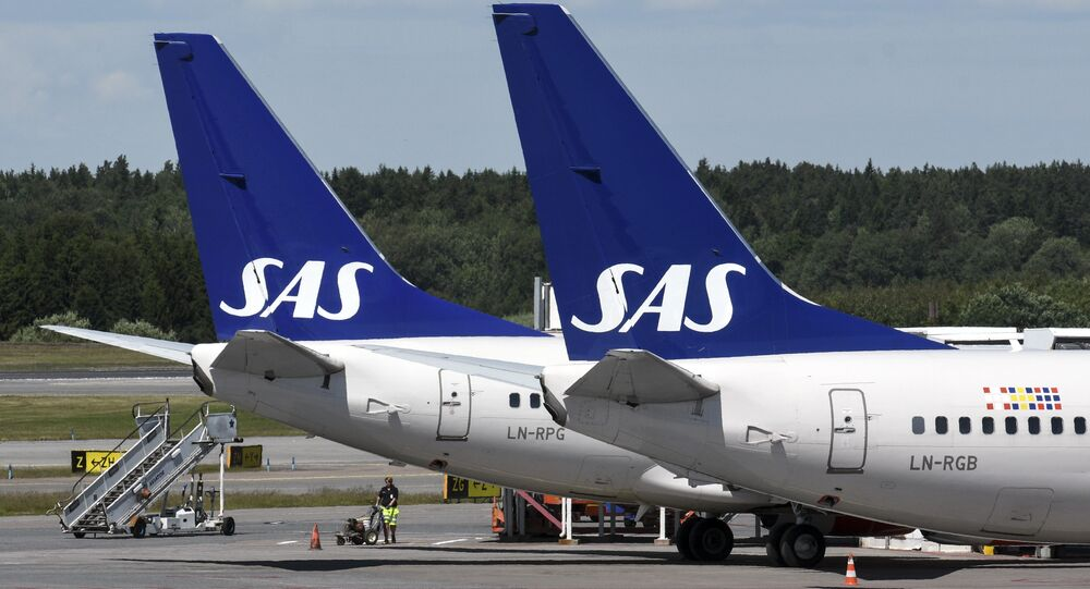 Two of Scandinavian airline (SAS) Boeing 737 aircrafts parked at Terminal 4 at Arlanda Airport in Stockholm, Sweden