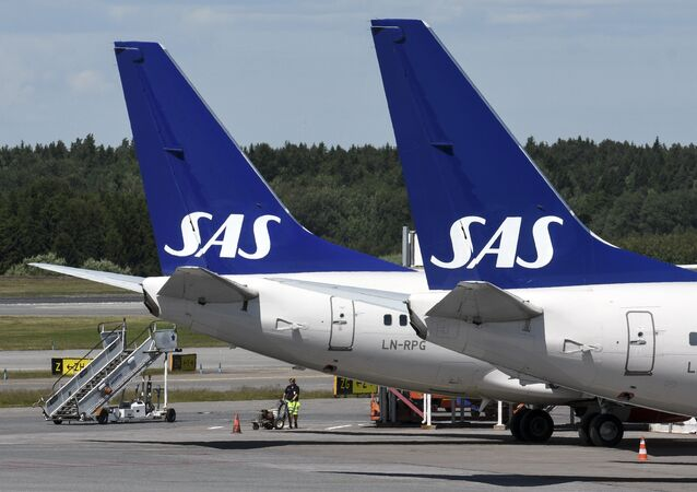 Two Scandinavian airline (SAS) Boeing 737 aircraft parked at Terminal 4 at Arlanda Airport in Stockholm, Sweden