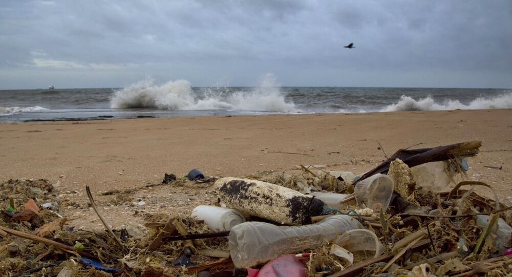 In this Aug. 13, 2015 photo, a plastic bottle lies among other debris washed ashore on the Indian Ocean beach in Uswetakeiyawa, north of Colombo, Sri Lanka. For years along the Cornish coast of Britain, Atlantic Ocean currents have carried thousands of Lego pieces onto the beaches. In Kenya, cheap flip-flop sandals are churned relentlessly in the Indian Ocean surf, until finally being spit out onto the sand. In Bangladesh, fishermen are haunted by floating corpses that the Bay of Bengal sometimes puts in their path. And now, perhaps, the oceans have revealed something else: parts of Malaysian Airlines Flight 370, the jetliner that vanished 17 months ago with 239 people on board.