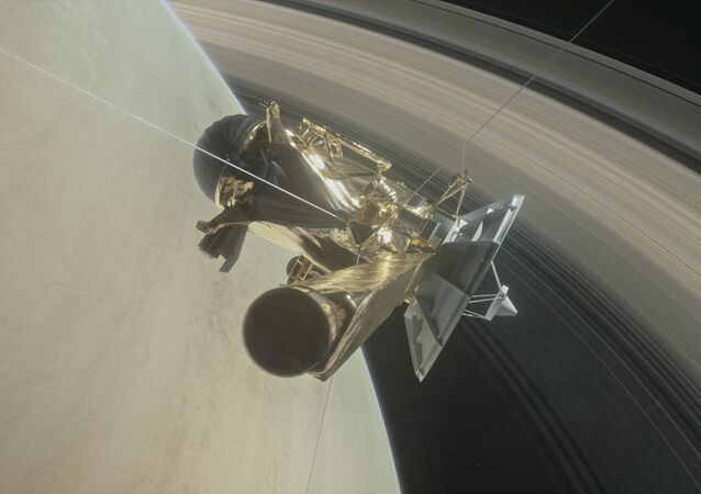 This illustration of NASA's Cassini spacecraft about to make one of its dives between Saturn and its innermost rings as part of the mission's grand finale.