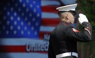 An officer of the US Marine Corps Color Guard stands at attention during the flag raising ceremony at the official opening of National Day USA at the Expo 2015 world's fair in Rho, near Milan, Italy, 4 July 2015.