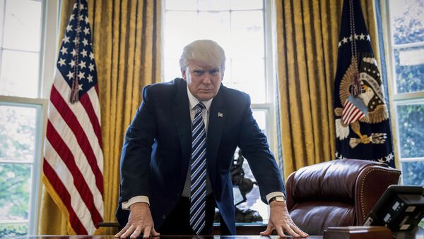 In this April 21, 2017, file photo, President Donald Trump poses for a portrait in the Oval Office in Washington after an interview with The Associated Press. - Sputnik International