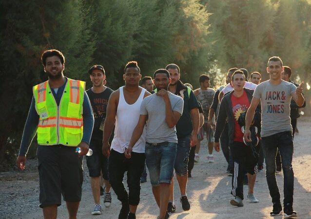 Refugees helping other refugees find safety.