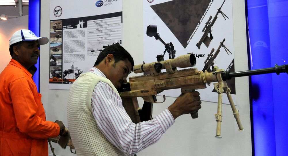 An Indian exhibition visitor takes aim with a Punj Lloyd's Gepard GM6LYNX rifle at the DefExpo 2010 in New Delhi. (File)
