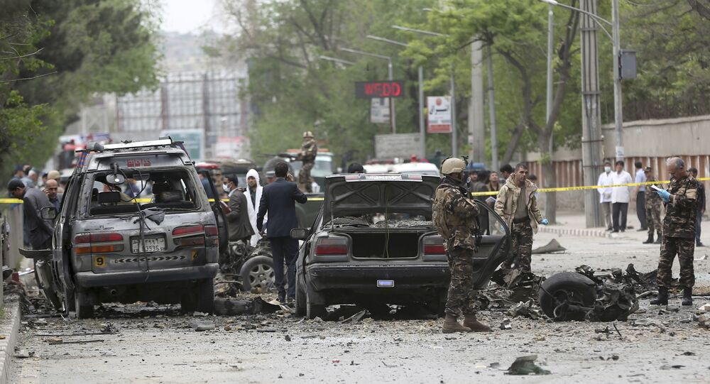 Security forces inspect the site of a suicide attack in Kabul, Afghanistan, Wednesday, May 3 , 2017