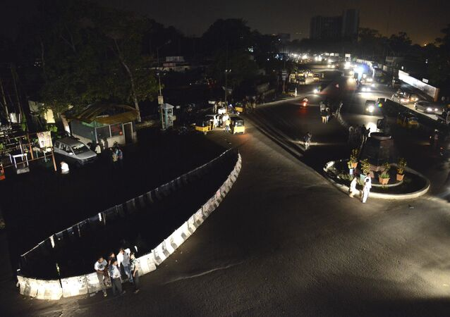 A view of one of the major junctions during a power outage at Visakhapatnam, Andhra Pradesh state, Tuesday, Oct. 8, 2013