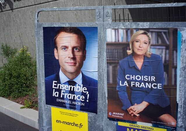 New official posters for the candidates for the 2017 French presidential election, Emmanuel Macron (L), head of the political movement En Marche !, or Onwards !, and Marine Le Pen (R), French National Front (FN) political party leader, are displayed in Fontaines-sur-Saone, near Lyon, France, April 30, 2017