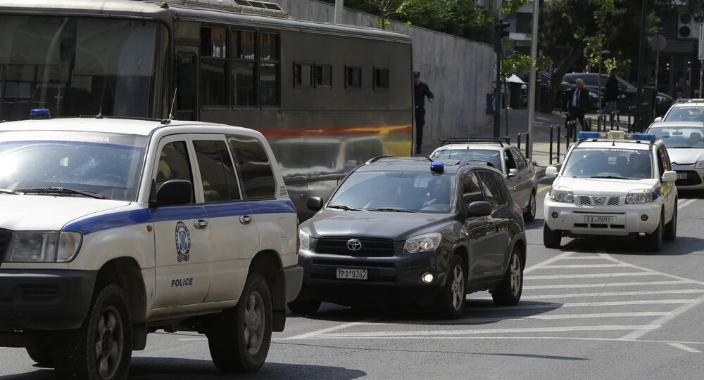 Three of the eight Turkish military officers are transferred in a police convoy to a court in Athens, Tuesday, April 25, 2017