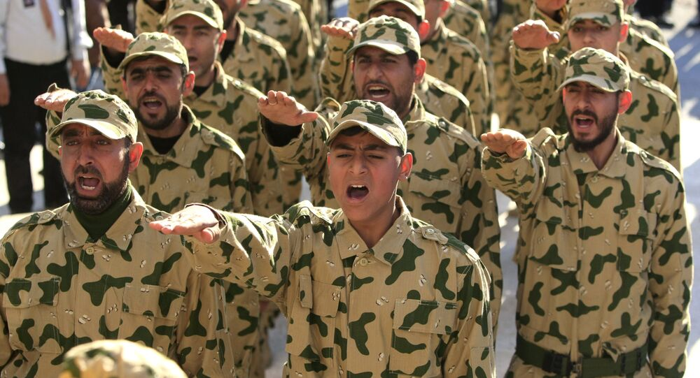 Hezbollah fighters parade during a ceremony to honor fallen comrades, in Tefahta village, south Lebanon, Saturday, Feb. 18, 2017