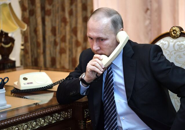 Russian President Vladimir Putin during his telephone conversation with President of Turkmenistan Gurbanguly Berdimukhamedov, also involving President of the Republic of Tajikistan Emomali Rakhmon