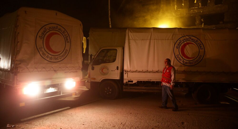 An aid convoy of food and medical supplies reaches the rebel-held besieged Syrian town of Douma, Damascus, Syria May 3, 2017