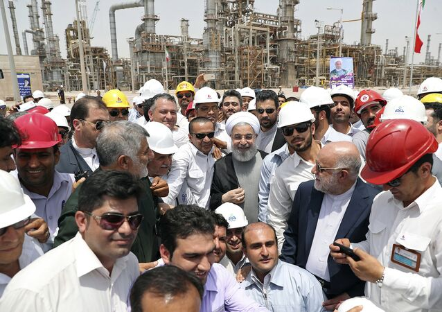 In this photo released by an official website of the office of the Iranian Presidency, Sunday, April 30, 2017, Iranian President Hassan Rouhani, center, inaugurates a new refinery that produces some 12 million liters (3.17 million gallons) of gas in its first phase, in Bandar Abbas, some 750 miles (1,205 kilometers) south of Tehran, Iran