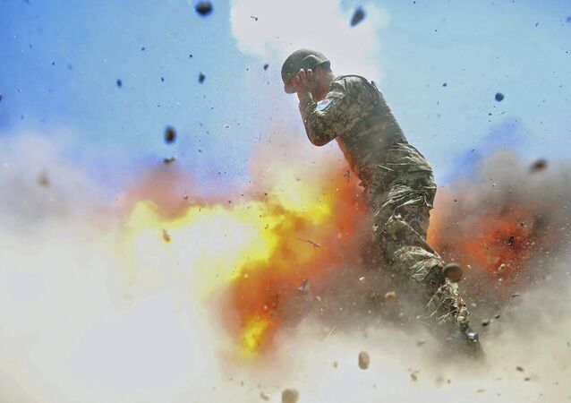 U.S Army combat camera photographer Spc. Hilda Clayton took this photo July 2, 2013 that was released by the U.S. Army, that shows an Afghan soldier engulfed in flame as a mortar tube explodes during an Afghan National Army live-fire training exercise in Laghman Province, Afghanistan. The accident killed Clayton and four Afghan National Army soldiers