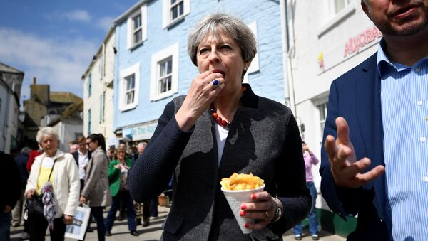 Britain's Prime Minister Theresa May enjoys some chips during a campaign stop in Mevagissey, Cornwall, May 2, 2017 - Sputnik International
