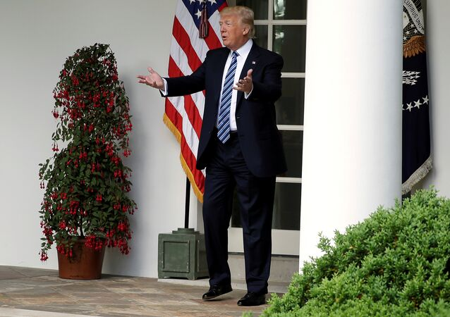 US President Donald Trump speaks to staffers setting up for the Commander in Chief's trophy presentation in the Rose Garden of the White House in Washington, US, May 2, 2017.