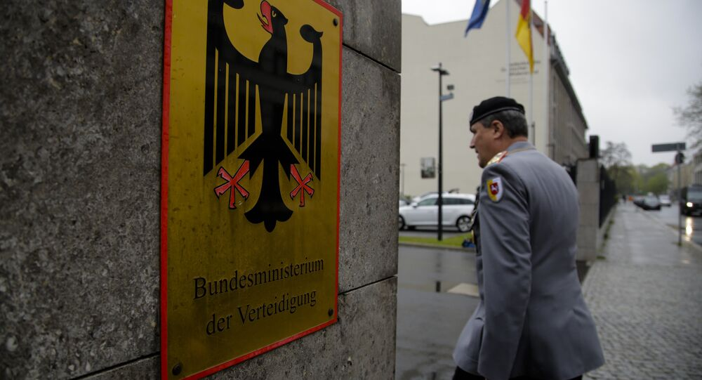 A German forces Bundeswehr officer enters the German Defense Ministry prior to a meeting between Defense Minister Ursula von der Leyen and about 100 top officers in Berlin, Thursday, May 4, 2017.