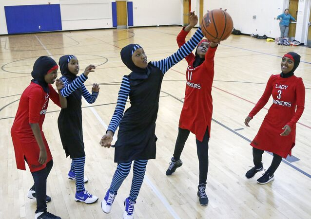 In this June 16, 2015 photo, East African Muslim girls practiced basketball in their new uniforms in Minneapolis