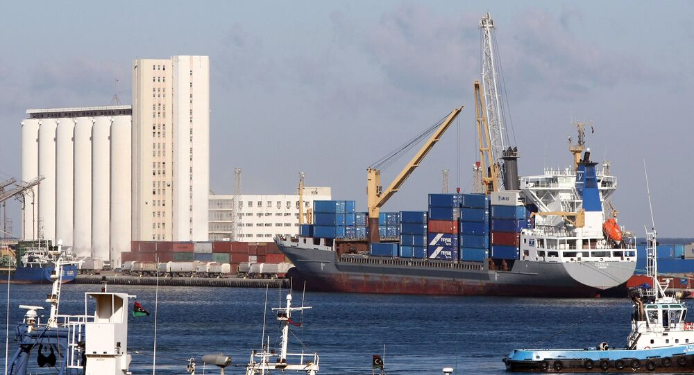 (File) A cargo ship docks at the port of the Libyan capital Tripoli on February 16, 2012