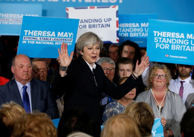 Britain's Prime Minister Theresa May delivers a speech to Conservative Party members in Mawdesley village hall, Ormskirk, Britain May 1, 2017