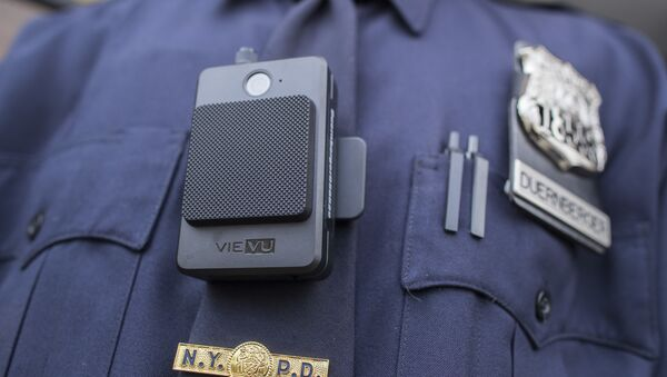 A police officer wears a newly issued body camera outside the 34th precinct, Thursday, April 27, 2017, in New York. - Sputnik International