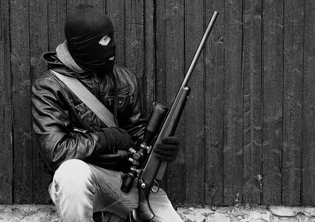 A man holding a rifle