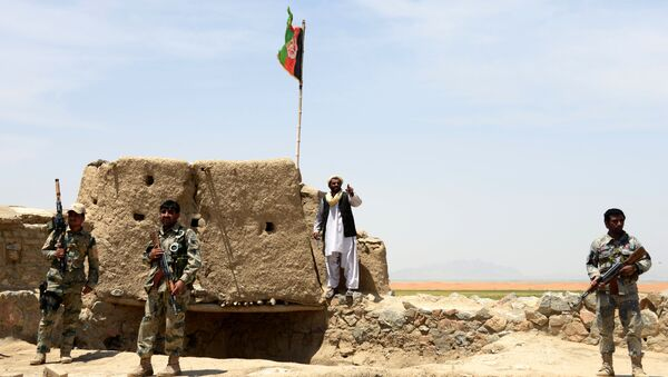 Afghan Border Police personnel keep watch during an ongoing battle between Pakistani and Afghan Border forces near the Durand line at Spin Boldak, in southern Kandahar province on May 5, 2017 - Sputnik International