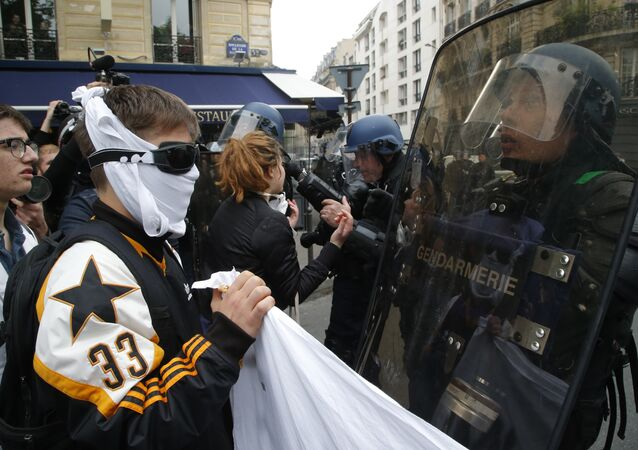 High school children face riot police officers during a demonstration in Paris, Friday May, 5, 2017