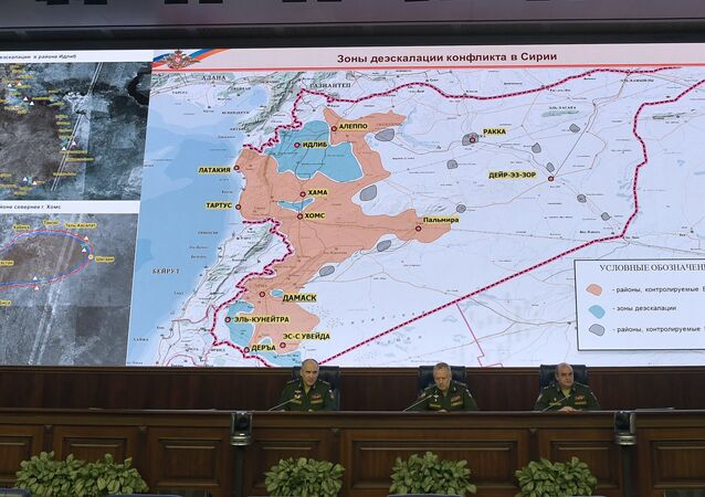 Senior Russian military commander Sergei Rudskoi (L) speaks during a news briefing on the situation in Syria, Moscow, May 5, 2017
