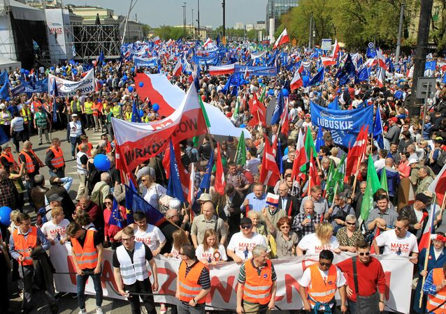 People gather at an anti-government demonstration called March of Freedom organised by opposition parties in Warsaw, Poland May 6, 2017