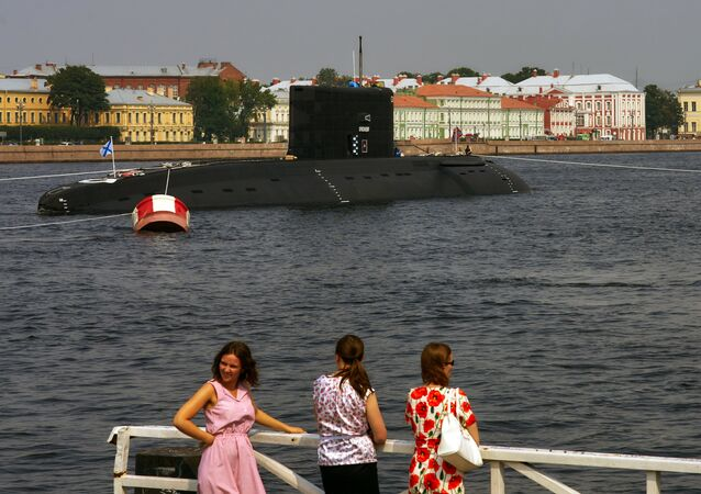 Diesel-electric submarine Krasnodar enters the Neva River to take part in the July 31 parade marking Russian Navy Day. File photo