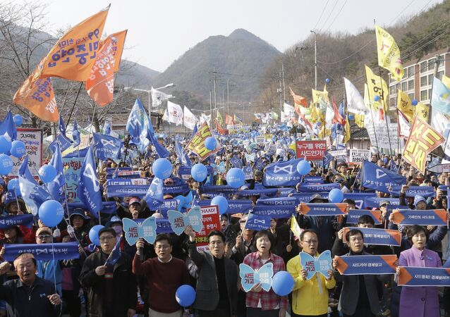 Protesters stage a rally to oppose the deployment of US Terminal High-Altitude Area Defense (THAAD) missile defence system in Seongju in South Korea