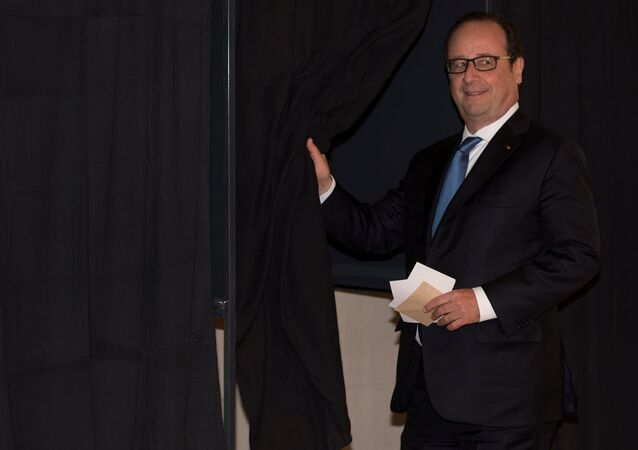 French President Francois Hollande prepares to vote in the second round of 2017 French presidential election at a polling station in Tulle, France