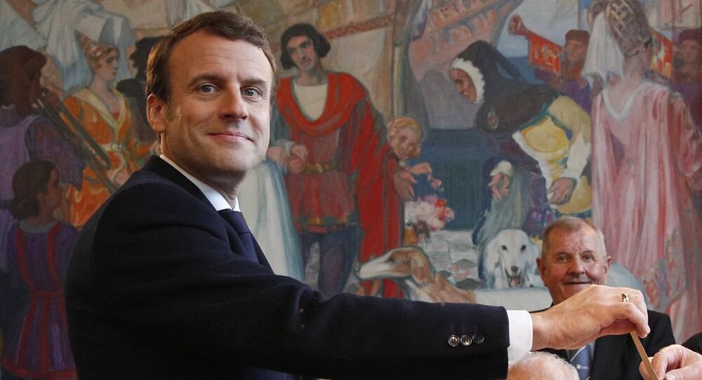 French independent centrist presidential candidate Emmanuel Macron casts his ballot in the presidential runoff election in Le Touquet, France, Sunday, May 7, 2017.