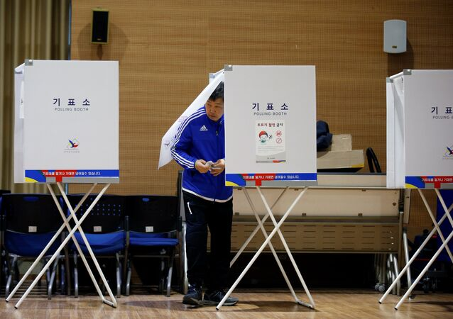 A man prepares to cast his vote at a polling station during the presidential elections in Seoul, South Korea May 9, 2017.