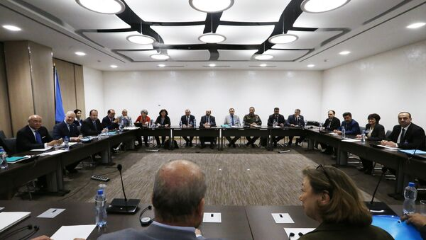 Nasr al-Hariri (R), Head of the Syrian High Negotiations Committee (HNC) opposition group attends a meeting with UN Special Envoy of the Secretary-General for Syria Staffan de Mistura (2ndL) prior to a round of negotiation, during the Intra Syria talks in Geneva. (File) - Sputnik International