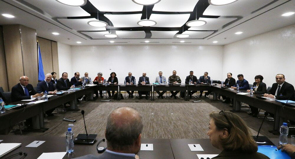 Nasr al-Hariri (R), Head of the Syrian High Negotiations Committee (HNC) opposition group attends a meeting with UN Special Envoy of the Secretary-General for Syria Staffan de Mistura (2ndL) prior to a round of negotiation, during the Intra Syria talks in Geneva. (File)