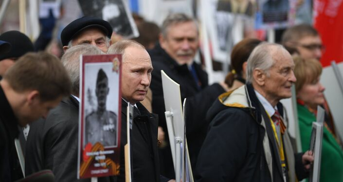 Russian President Vladimir Putin attends Immortal Regiment march during Victory Day celebrations, marking 72nd anniversary of victory over Nazi Germany in World War Two, at Red Square in central Moscow