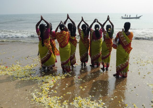 Indian women offer prayers at Marina Beach in Chennai